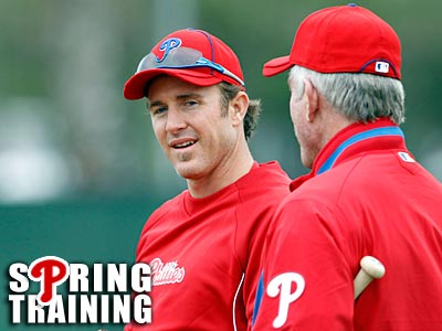 Chase Utley speaks with Mike Schmidt at the Phillies workout on Monday. (Yong Kim/Staff Photographer)