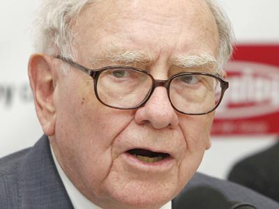 Billionaire Warren Buffett said Monday that Berkshire Hathaway may sell its stake in Johnson & Johnson. (Shuji Kajiyama / Associated Press)