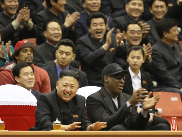 North Korean leader Kim Jong Un, left, and former NBA star Dennis Rodman watch North Korean and U.S. players in an exhibition basketball game at an arena in Pyongyang, North Korea, Thursday, Feb. 28, 2013. (AP Photo/VICE Media, Jason Mojica)