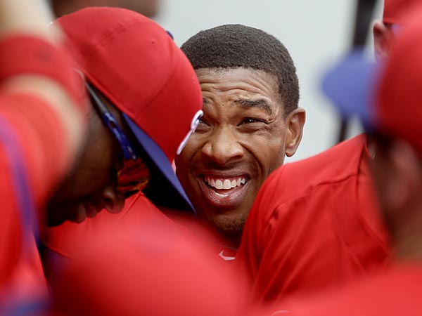 Philadelphia Phillies&acute; Ben Revere, center, is high-fived by teammates<br />after scoring on a single by Ryan Howard in the first inning of an<br />exhibition spring training baseball game against the Minnesota Twins,<br />Wednesday, Feb. 27, 2013, in Fort Myers, Fla. (AP Photo/David Goldman)