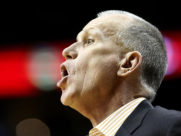 Philadelphia 76ers coach Doug Collins calls out from the bench during the second half of an NBA basketball game against the Portland Trail Blazers in Portland, Ore., Saturday, Dec. 29, 2012. The Trail Blazers won 89-85.(AP Photo/Don Ryan)