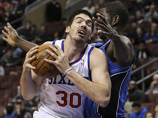 76ers forward Byron Mullens drives on the Magic´s Andrew Nicholson during the fourth quarter at the Wells Fargo Center  on Wednesday, February 26, 2014. (Steven M. Falk/Staff Photographer)