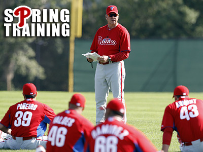 Rich Dubee goes over his plan with Phillies pitchers at Bright House Field in Clearwater.  (Yong Kim / Staff Photographer)