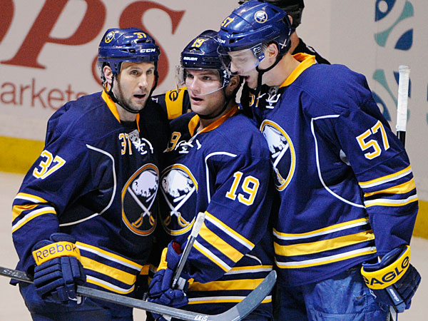 The Sabres´ Matt Ellis (37), Cody Hodgson (19) and Tyler Myers (57) celebrate Myers´ empty-net goal against the San Jose Sharks during the third period of an NHL hockey game in Buffalo, N.Y., Friday, Feb. 28, 2014. Buffalo won 4-2. (Gary Wiepert/AP)