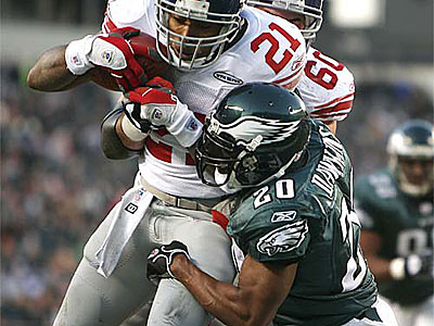 Brian Dawkins tries to drag down Giants RB TIki Barber in a 2005 game at Lincoln Financial Field. (Eric Mencher/Staff Photographer)