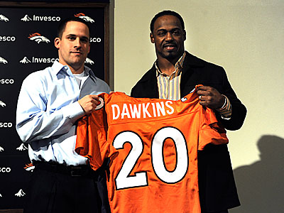 Former Eagles safety Brian Dawkins talks with the media while holding up his new Broncos jersey. (AP Photo/Reza A.Marvashti)