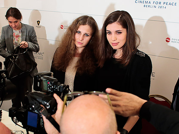 Pussy Riot member Nadezhda Tolokonnikova (right) wrote on Twitter that she and Maria Alekhina (left) were stopped and accused of a crime. She said a third member of the loosely organized group also was detained. (Markus Schreiber/AP file photo)<br />