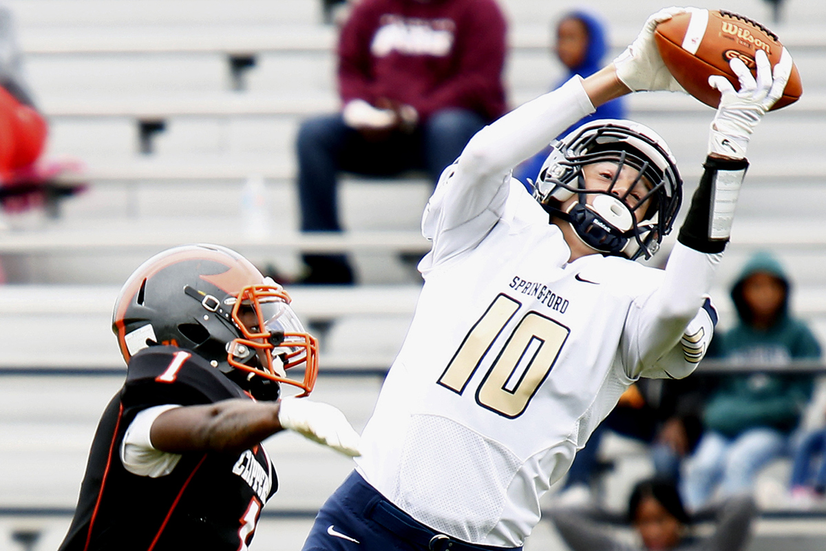 Spring-Ford receiver Dante Bonanni (10) goes up to catch a 30-yard pass over Chester defensive back Andre Cooper in the first quarter of a nonleague football game Saturday, Sept. 2, 2017 at the Chester Athletic Complex. Spring-Ford went on to win, 28-20.