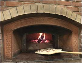 The wood burning oven was brought over from Italy.                                      (Photos: Jonathan Wilson)