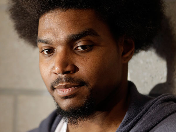 Andrew Bynum speaks to members of the media at the team´s NBA training facility Friday, March 1, 2013, in Philadelphia. (Matt Rourke/AP)