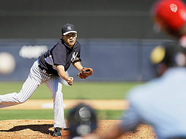 New York Yankees pitcher Masahiro Tanaka throws a pitch during the sixth inning against the Philadelphia Phillies. (AP Photo/Charlie Neibergall)
