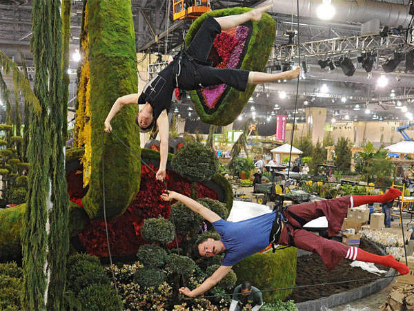 Vertical dancers Jessica Swanson and Roel Seeber (above, left), of California, practice their Flower Show routine. Guests can get up close to butterflies at the show (bottom, left). At right (top), Sidney Allen (left) and Jon Logan Jones look over Robertson´s Flowers & Events display. Below Sidney and Jon, Amy Mihalik (left) and Amy McClintock check out the Korea-inspired display.