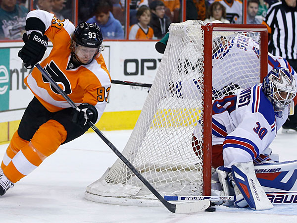 The Rangers´ Henrik Lundqvist, right, blocks a shot by Philadelphia Flyers´ Jakub Voracek during the second period of an NHL hockey game, Saturday, March 1, 2014, in Philadelphia. (Matt Slocum/AP)