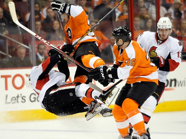 Philadelphia Flyers&acute; Harry Zolnierczyk, center, collides with Ottawa<br />Sentors&acute; Mike Lundin, left, in front of Flyers&acute; Zac Rinaldo (36) and<br />Sentors&acute; Peter Regin (13) during the first period on Saturday, March 2, 2013, in Philadelphia. (Michael Perez/AP)