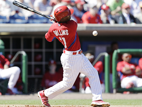 Phillies shortstop Jimmy Rollins bats during a spring training game at Bright House Field in Clearwater, Florida. (Charlie Neibergall/AP)