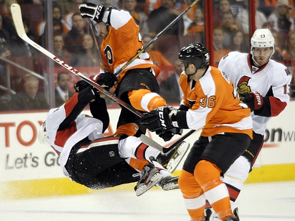 Philadelphia Flyers&acute; Harry Zolnierczyk, center, collides with Ottawa<br />Sentors&acute; Mike Lundin, left, in front of Flyers&acute; Zac Rinaldo (36) and<br />Sentors&acute; Peter Regin (13), of Denmark, during the first period of an<br />NHL hockey game, Saturday, March 2, 2013, in Philadelphia. (AP<br />Photo/Michael Perez)