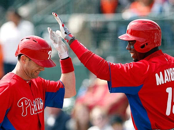 Phillies&acute; Michael Young, left, and John Mayberry Jr. celebrate Young&acute;s<br />two run homer in the third inning as the Phillies play the Baltimore<br />Orioles in Sarasota, Fl. on March 3, 2013. (David Maialetti/Staff<br />Photographer)