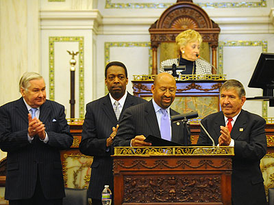 Philadelphia Mayor Michael Nutter walks to the podium of city council chambers to the applause of (from left) Councilmen Jack Kelly, Darrell Clarke, Frank Rizzo Jr., and Council President Anna C. Verna is at top. (Clem Murray / Staff Photographer)