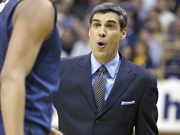 Villanova head coach Jay Wright, right, talks with a player in the<br />first half of an NCAA college basketball game against Pittsburgh,<br />Sunday, March 3, 2013, in Pittsburgh. Pittsburgh won 73-64 in<br />overtime. (AP Photo/Keith Srakocic)
