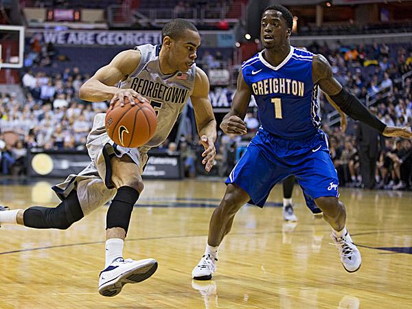 Georgetown guard Markel Starks (5) drives past Creighton guard Austin Chatman. (Evan Vucci/AP)