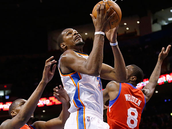 Oklahoma City Thunder forward Kevin Durant (35) shoots between<br />Philadelphia 76ers forward Jarvis Varnado (40) and guard Tony Wroten<br />(8) during the third quarter. (AP Photo/Sue Ogrocki)