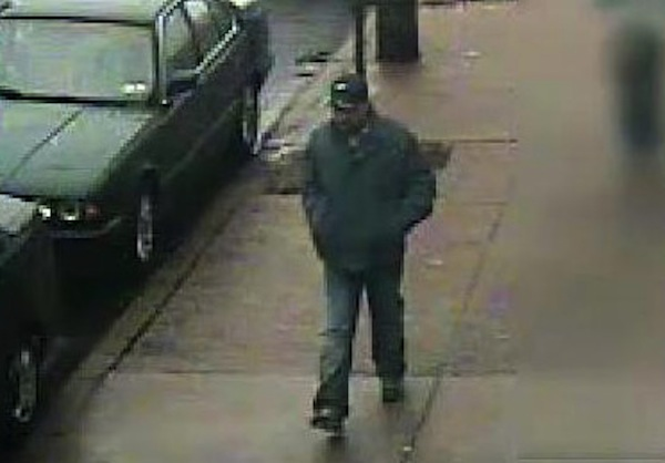 Surveillance photograph of the suspect in a Feb. 23 burglary. Cops say the man posed as a Philadelphia Gas Works employee to gain entry to an elderly couple´s home. (Courtesy of Philadelphia police)