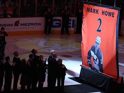 Former Flyer Mark Howe and his family watch the raising of his banner in the Wells Fargo Center. (Steven M. Falk/Staff Photographer)