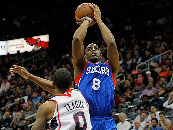 76ers shooting guard Damien Wilkins shoots over Hawks point guard Jeff Teague. (Todd Kirkland/AP)