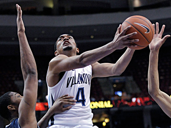 Villanova´s Darrun Hilliard drives past Georgetown´s Mikael Hopkins, left, during the second half of an NCAA college basketball game, Wednesday, March 6, 2013, in Philadelphia. Villanova won 67-57. (Michael Perez/AP)