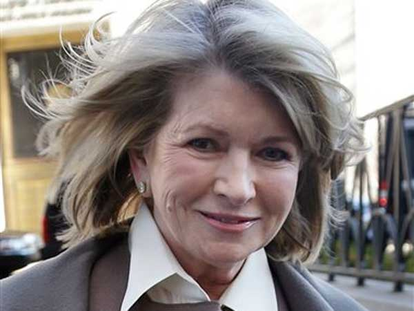 Martha Stewart arrives to court in New York, Tuesday, March 5, 2013. Macy´s Inc. is suing the media and merchandising company Stewart founded for breaching an exclusive contract when she signed a deal with J.C. Penney in December 2011 to open shops at most of its stores this spring.(AP Photo/Seth Wenig)