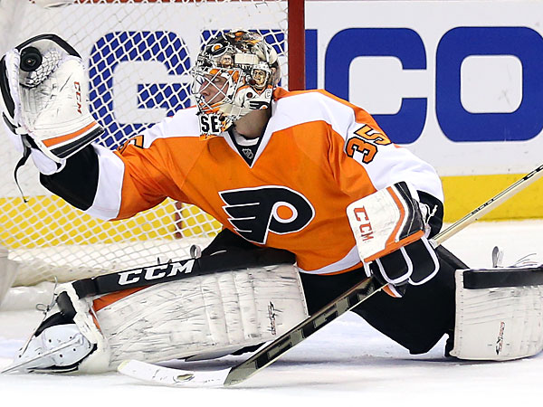 Steve Mason saves the puck with his glove during the second period against the Capitals on Wednesday, March 5, 2014. (Yong Kim/Staff Photographer)