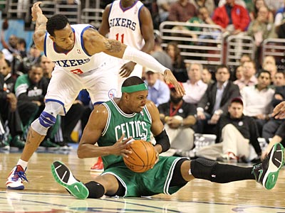 Andre Iguodala closes in on Paul Pierce after a scramble for a loose ball in the first half. (Charles Fox/Staff Photographer)
