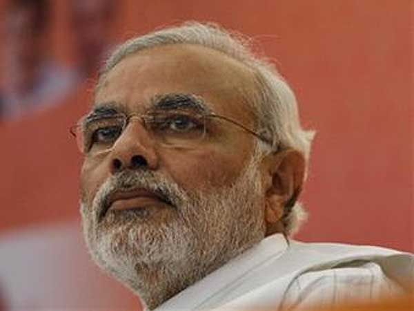 In this Monday, Dec. 3, 2012 photo, Gujarat Chief Minister Narendra Modi attends a press conference.  (AP File Photo / Ajit Solanki)