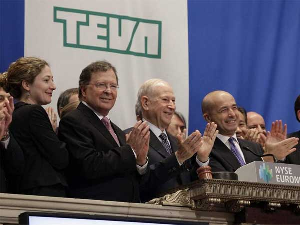 Teva Pharmaceuticals officials (from left) CFO Eyal Desheh, Chairman Phillip Frost and CEO Jeremy Levin during opening bell ceremonies of the New York Stock Exchange. (Richard Drew / Associated Press, File)
