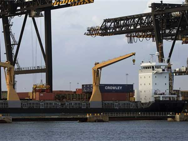 A ship is loaded with cargo in Fort Lauderdale, Fla.  (AP File Photo/J Pat Carter)