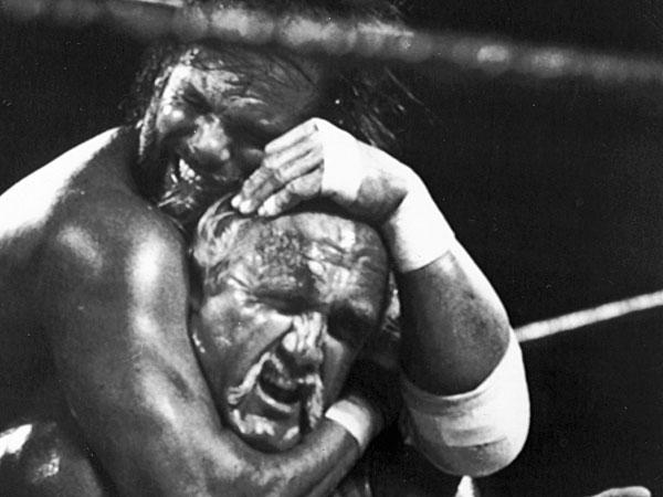 "Randy ""Macho Man"" Savage, top, has challenger Hulk Hogan in a headlock during the main event for Wresltemania V in Atlantic City, N.J. (B. Vartan Boyajian/AP file)"