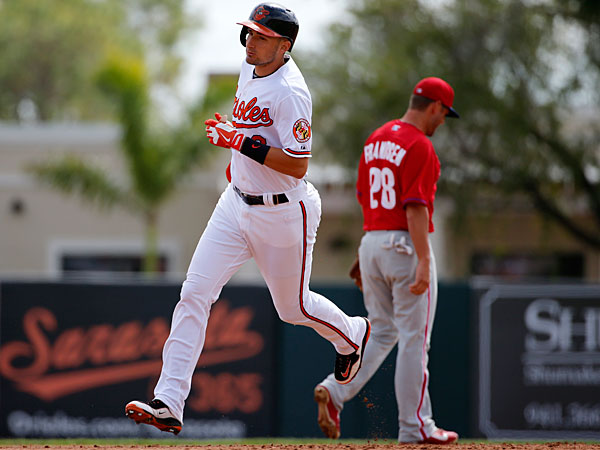 The Orioles´ Ryan Flaherty (3) rounds second past Philadelphia Phillies second baseman Kevin Frandsen (28) after hitting a two-run home run off Phillies starting pitcher A.J. Burnett in the second inning of an exhibition spring training baseball game in Sarasota, Fla., Friday, March 7, 2014. The Orioles won 15-4. (Gene J. Puskar/AP)