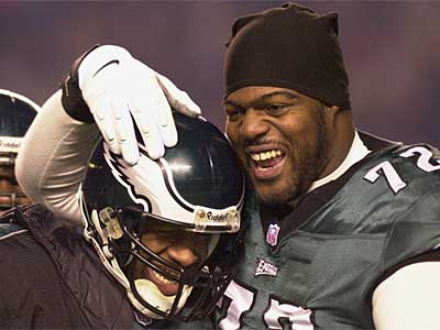Tra Thomas celebrates a touchdown with Donovan McNabb during the 2000 playoffs. Thomas spent 11 seasons with the Eagles, but will suit up for the Jaguars next season after agreeing to a three-year deal. (File photo)