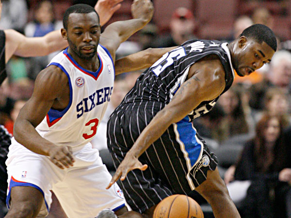 Orlando Magic´s E´Twaun Moore (55) and Philadelphia 76ers´ Charles Jenkins, left chase a loose ball in the second half of an NBA basketball game, Tuesday, Feb. 26, 2013, in Philadelphia. (H. Rumph Jr/AP)
