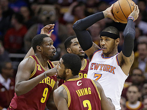 The Knicks´ Carmelo Anthony looks for help from a teammate under pressure from the Cavaliers´ Kyrie Irving, Luol Deng and Tristan Thompson. (Tony Dejak/AP)