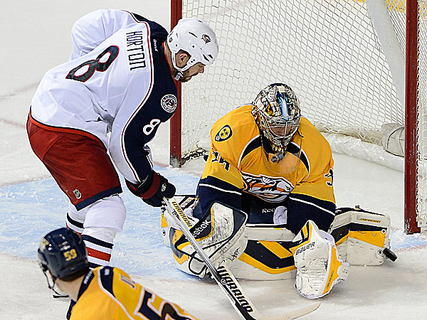 Blue Jackets forward Nathan Horton has his shot blocked by Predators goalie Pekka Rinne. (Mark Zaleski/AP)