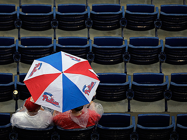 Philadelphia Phillies fans wait out a rain delay. (AP Photo/Matt Slocum)