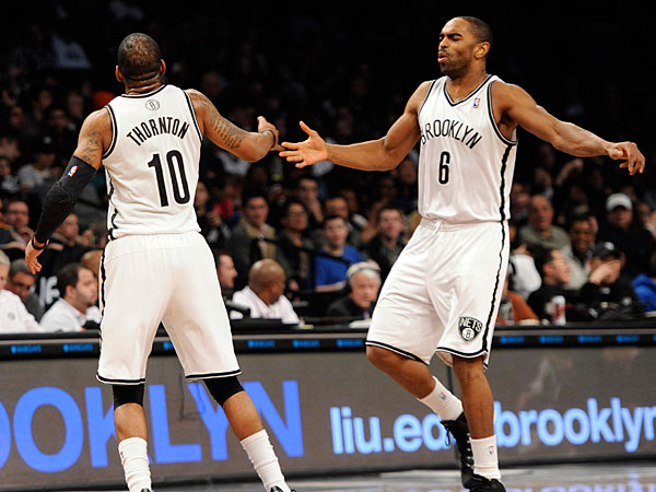The Nets´ Alan Anderson (6) congratulates Marcus Thornton (10) after Thornton shot a three pointer against the Sacramento Kings in an NBA basketball game on Sunday, March 9, 2014 at Barclays Center in New York. The Nets won 105-89. (Kathy Kmonicek/AP)
