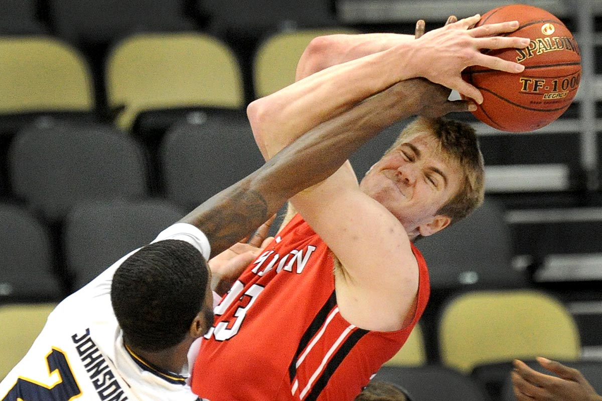 Sarah Spencer Sports.La Salle B.J. Johnson fouls Davidson Peyton Aldridge in the closing seconds at the A10 Championship at PPG Paints Arena on Thursday, Mar. 9, 2017. #9 Davidson defeated #8 La Salle 82-73.