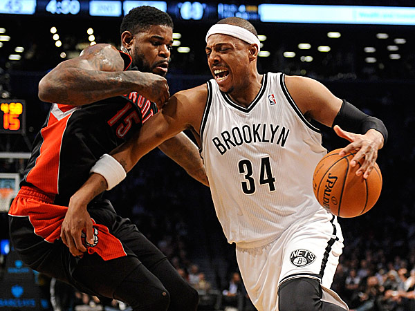 The Nets´ Paul Pierce drives the ball around the Raptors´ Amir Johnson. (Kathy Kmonicek/AP)