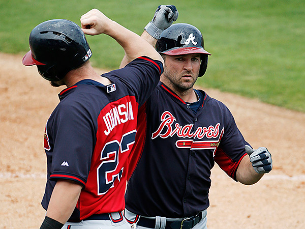 Atlanta Braves Chris Johnson, left, greets teammate Dan Uggla after scoring on Uggla´s fourth-inning, two-run homer. (AP Photo/Kathy Willens)