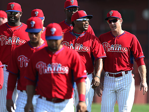 Phillies´ Marlon Byrd, center, talks with Chase Utley, right, as Ryan Howard, John Mayberry, and the rest of the Phillies walk off the field. (David Maialetti/Staff Photographer)