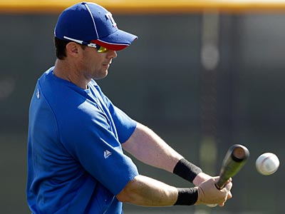 Michael Young batted .284 with 21 homers and 91 RBI for Texas last season. (Charlie Riedel/AP Photo)
