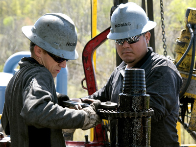 Workers move a section of well casing into place at a Chesapeake Energy natural gas well site near Burlington, Pa. in Bradford County Friday, April 23, 2010. (AP Photo/Ralph Wilson)