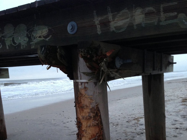"Damaged Ventnor Pier in March 2013, with the word ""Home"" scrawled into it."